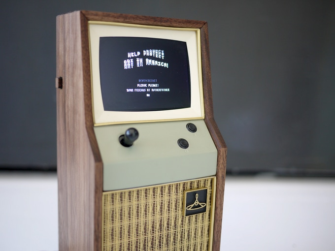 A micro arcade cabinet made out of walnut, masonite, 3D printed resin, and speaker cloth. In addition to playing video games, it contains hidden puzzles and compartments recipients must unlock to become fully lettered members of the College!