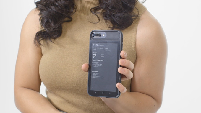 woman holding onto the inkcase i7 plus showing the live information center