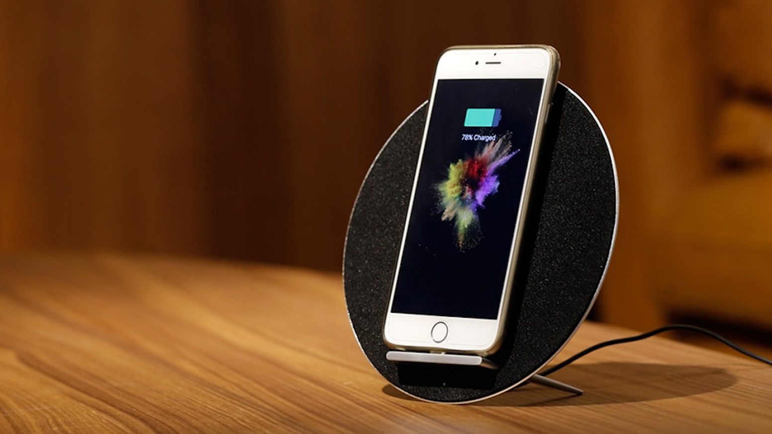 A monumental achievement to combine wireless charger, built-in Bluetooth speaker and phone stand into one unit.