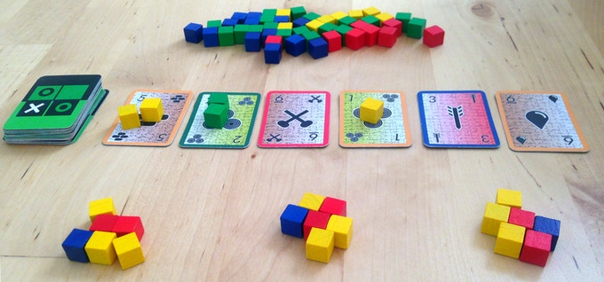 Gold Mine is a game of push-your-luck, where you have to decide how far you can go in search of valuable gold nuggets. It is perhaps the quickest game to set up in the entire Green Box repertoire, just shuffle the deck and you're ready to go.