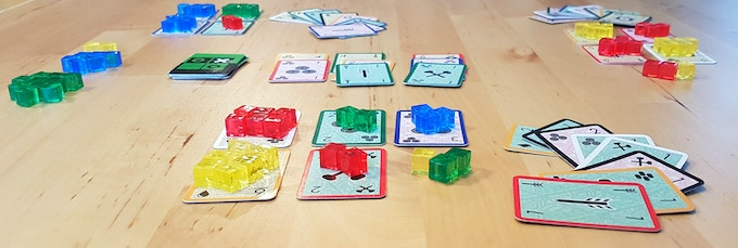 In Flower Garden the cards in your hand can have two functions: Play them in the shop to buy new flowers, or play them in your garden to plant the flowers you have bought.