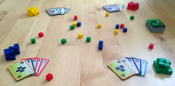 "Grenade Salad is a ""family war game"". You start by throwing a bunch of cubes onto the table, which serves as an open battlefield. Then you play cards to outsmart and eliminate the opposition."