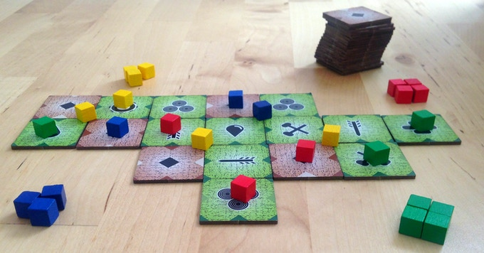 Modelled after the mother of all tile laying games, the Son of Kark challenges you to find the best placement and the most valuable action when placing a tile and a cube each turn.
