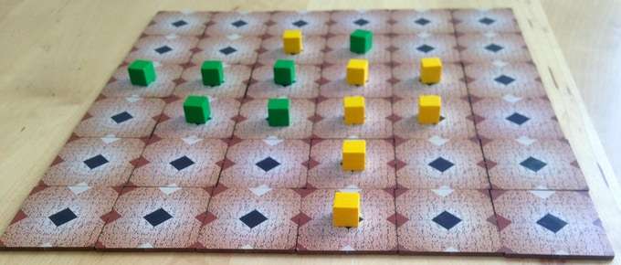 "The game of Othello takes ""a minute to learn, a lifetime to master"". The Green Box doesn't have enough pieces for a full game, but a compact version can be played on a 6×6 grid."