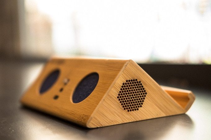 The opening on the side of the speaker is part of the acoustic chambers, enhancing the sound from the drums.