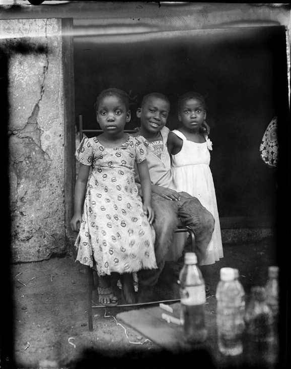 """A successful campaign will cure some of the film packet alignment flaws visible at the top of this decent negative. (Portrait of the children by Laena Wilder in """"Zanzibar Memoir"""")"""