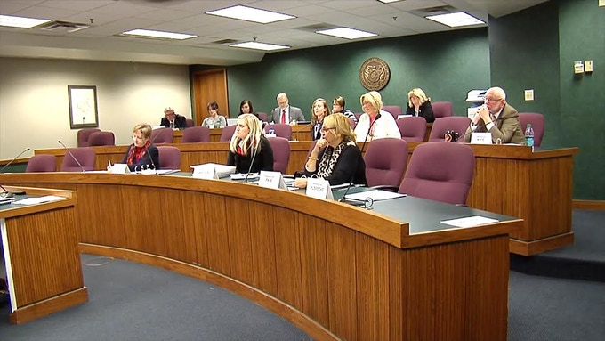 A Missouri state legislative committee sits transfixed as the Dietl's testify.