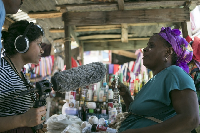 Here I am interviewing a vendor of Vodou-related products in Gonaives, Haiti.