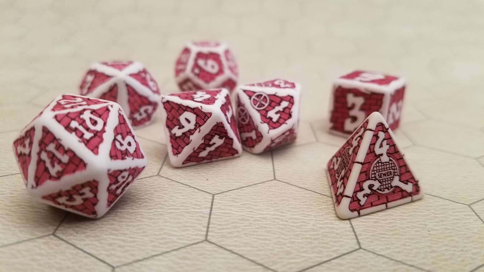 Stand out at your next table top game day with this uniquely designed set of 7 polyhedral dice. Laser Engraved for incredible detail!