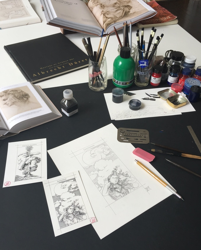 "Peter's drawing table at the studio. / Pencil sketch of the ""Intuition"" card and finished inking of ""Deus Ex Machina"" & ""Intuition"""