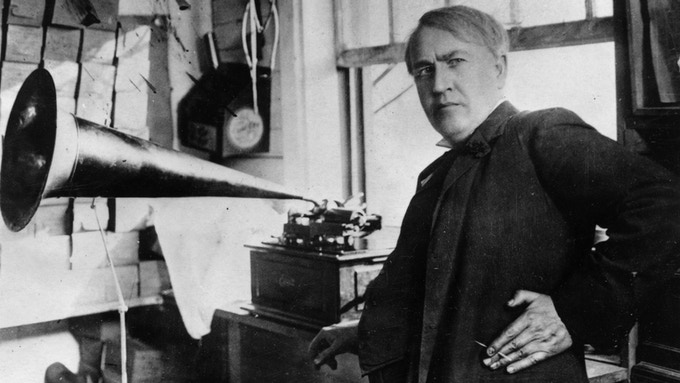 Thomas Edison with his invention.