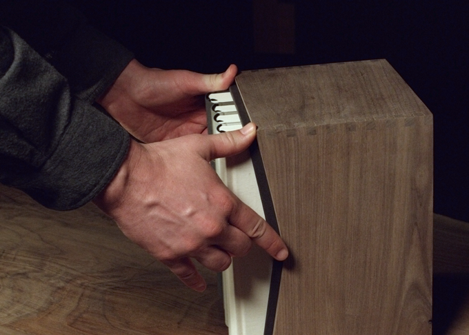 The standard paperboard slipcase (included with all sets) fits snugly into the walnut slipcase.