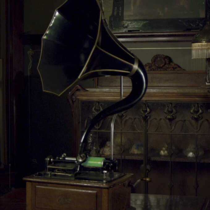 Welcome To My Nightmare glowing wax cylinder, playing on a phonograph.