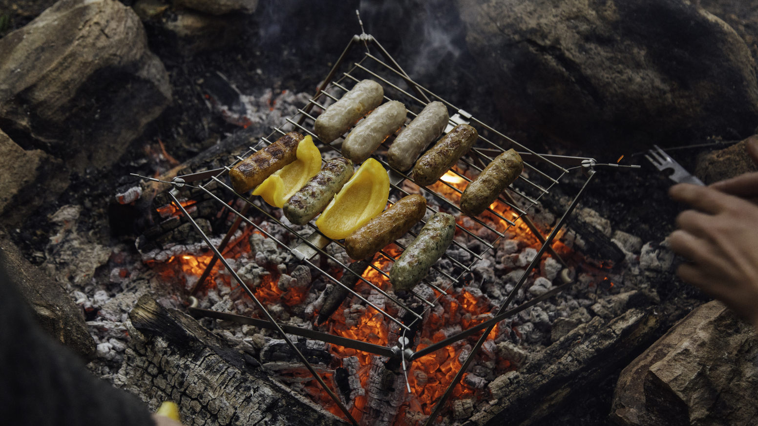 The camping grill that's as portable as your lunch: for the woods, beach and city.