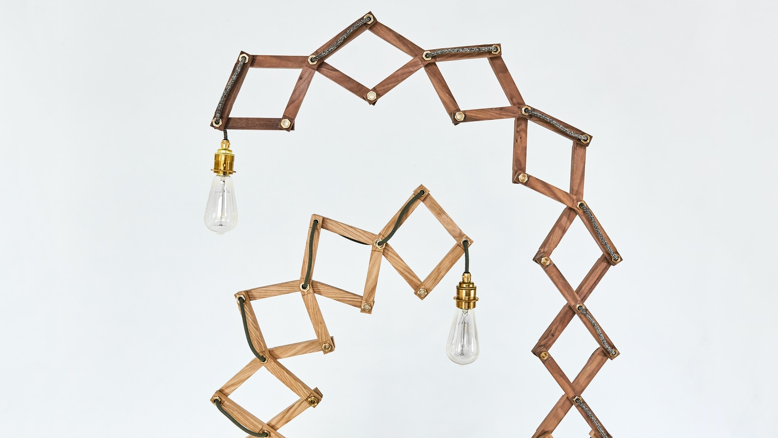 The Crane Lamp is a playful, kinetic light that can change dramatically in height and shape to suit your home.