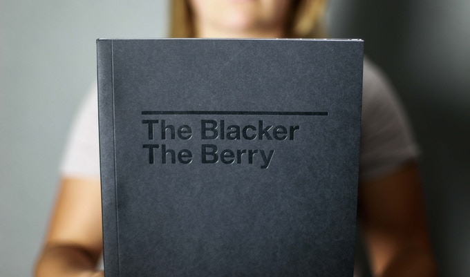 the book's cover is foil stamped on black cardstock for a black on black appearance