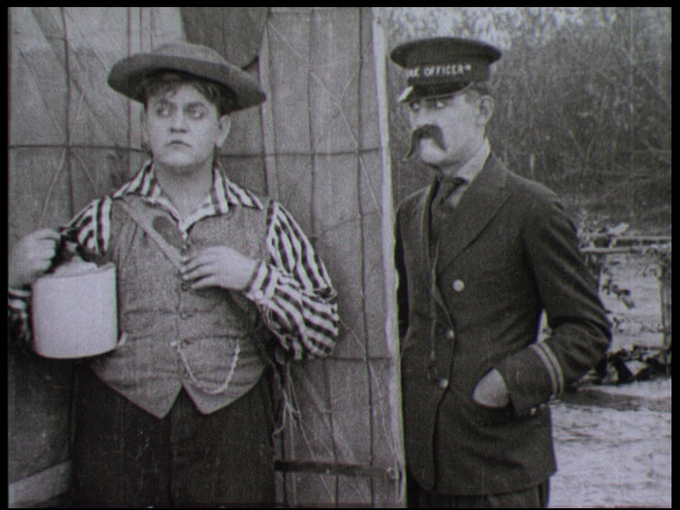 Yep, that's Charley Chase on the right, who also directed this film.