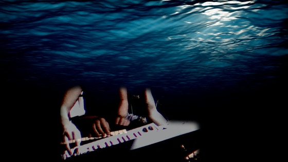A musician on board The Ocean Mapping Expedition