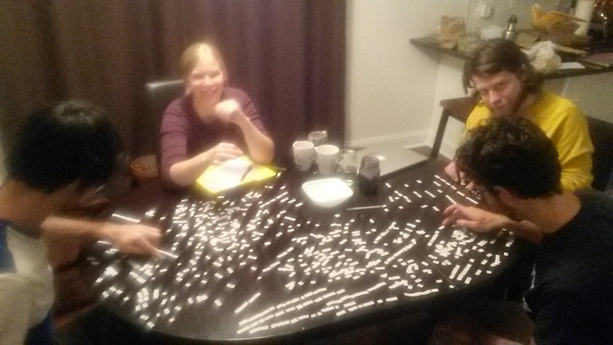 The Post-Jaded team playing with an early handmade prototype set.