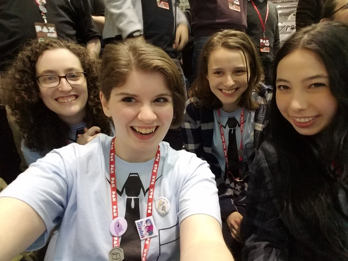 From left to right: Adi Slepack (Co-Creator & Lead Designer), Liz Roche (Game Dev Assistant), Ellie Black (Co-creator, Game Designer, and Concept Artist), and amazing volunteer Lucy at PAXEast!