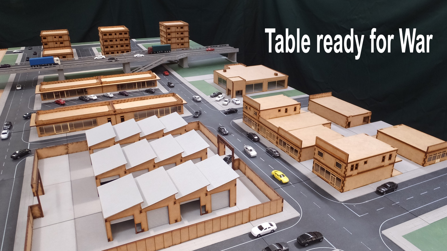 A system of road tiles that connect together with a variety of buildings and other structures to build a table worth fighting over.