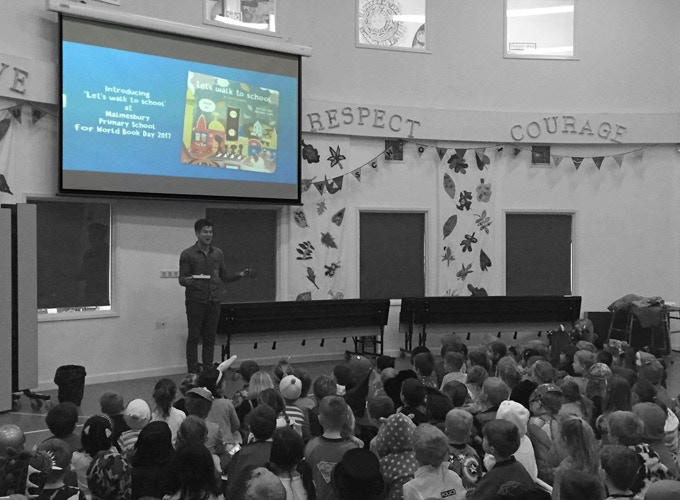 Tom presenting 'Let's walk to school' to children at Malmesbury Primary School for World Book Day 2017