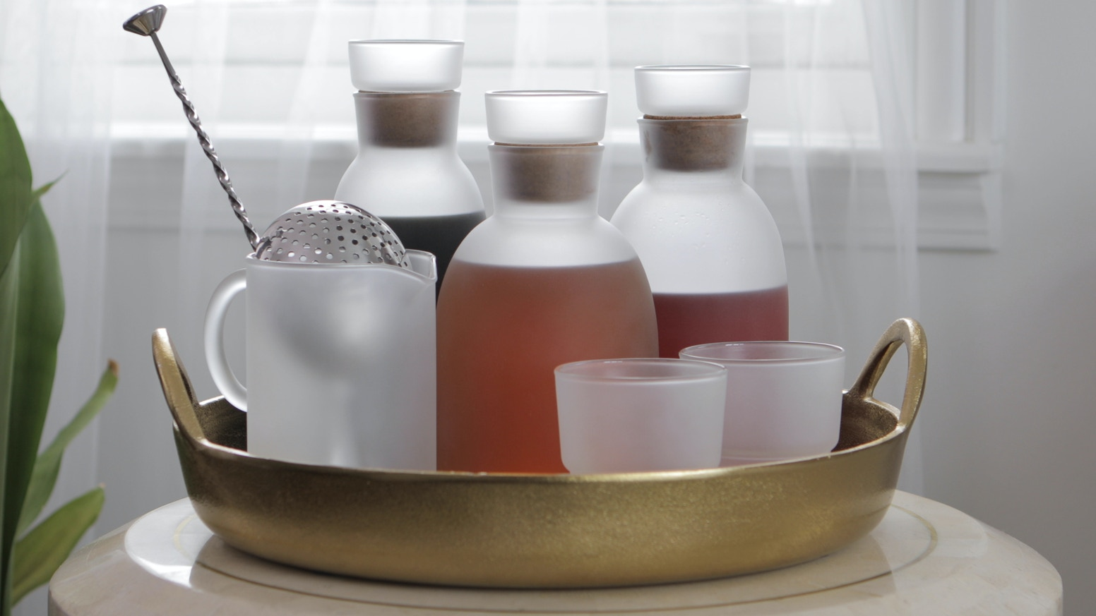 Elevate your home cocktail game with a sculptural set of hand-blown decanters and accessories.