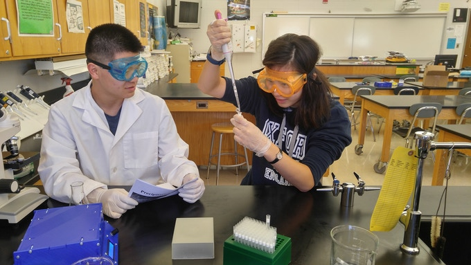 High school seniors Catherine Yang and Harry Feng prepare solutions for centrifugation using Polyfuge.
