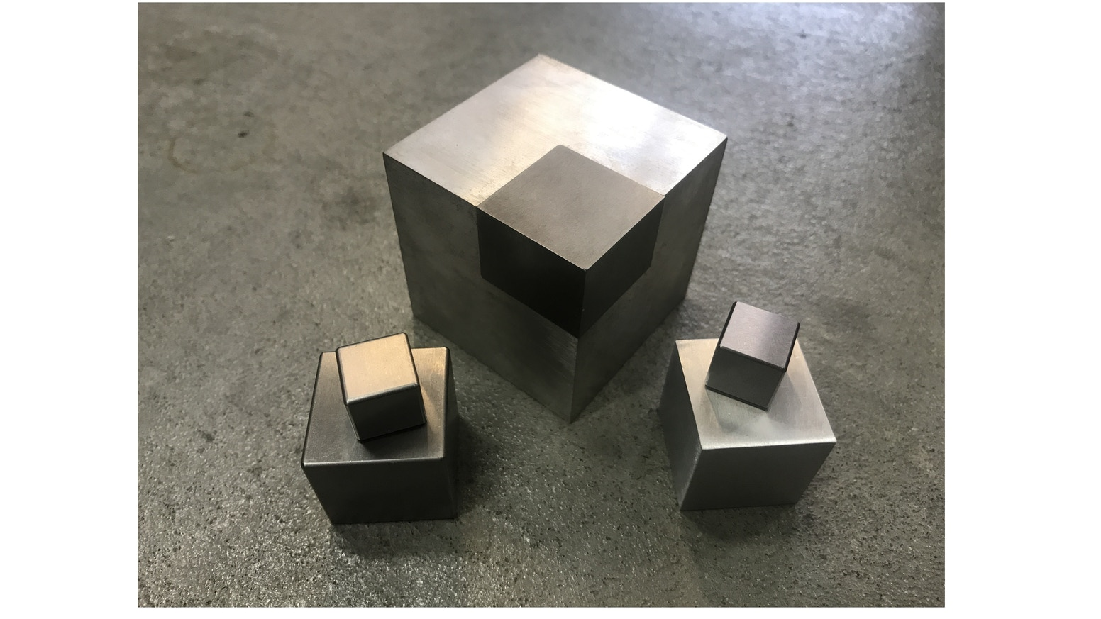 CNC machined block consisting of two detachable element components (Magnesium / Tungsten), each providing 50% of the Cube's total mass.
