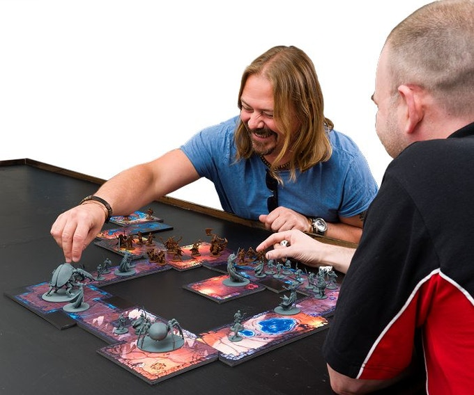 Two happy fellows enjoying a game of Darkholds!