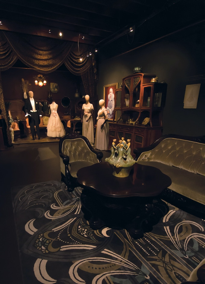 Costumes from The Great Gatsby on display among Art Nouveau furniture and objects at the Century Guild Museum of Art in Los Angeles