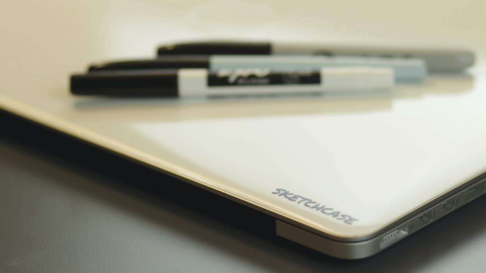 Get more out of your laptop by turning the empty space into a whiteboard.
