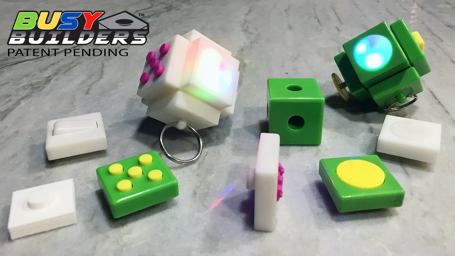 Interlocking fidget pieces, packaged in blind bags, that allow you to collect and build a custom fidget toy or spinner.