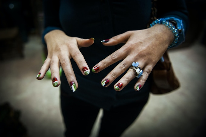 Beauty is important everywhere, A girl shows off her Palestinian themed nails.  Girls in Gaza are concerned with their appearance just like others around the world.