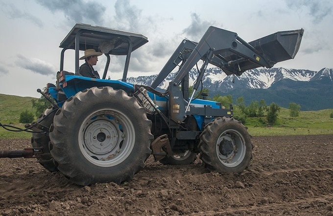 Patrick and his blue tractor are a common sight on the farm.