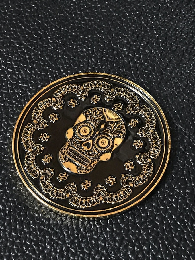 Golden brass coin with enamel finish