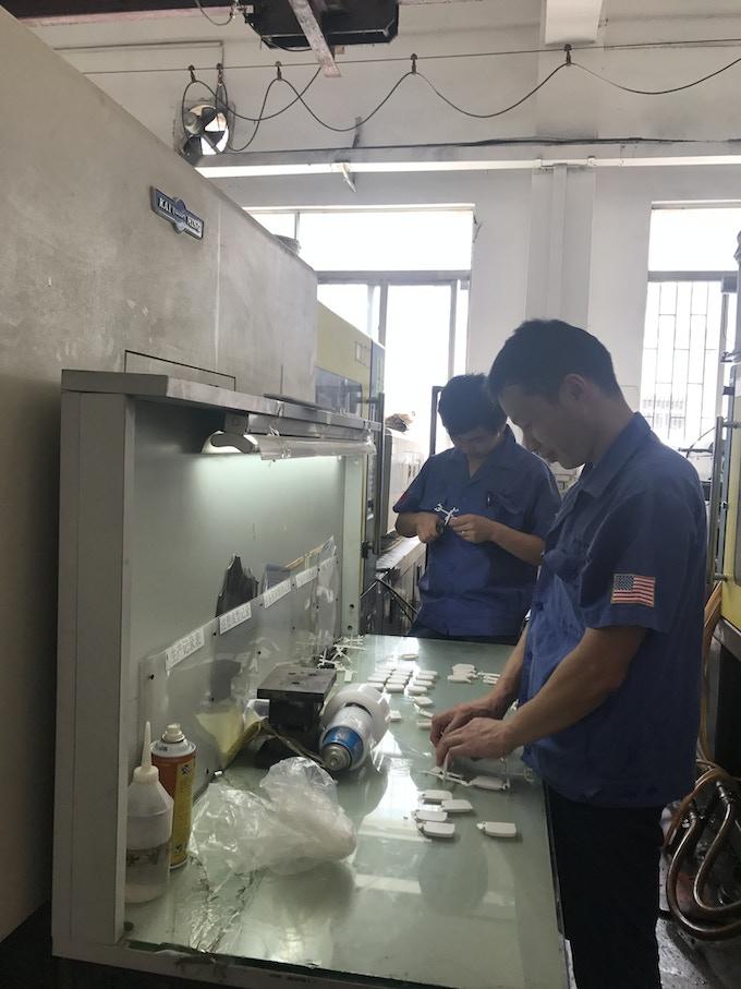 Worker assembling DigiBit systems