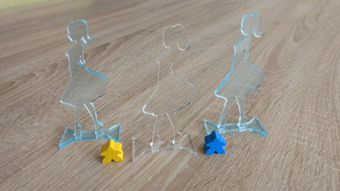 Samples of starting player marker (final version will be full color and not shine through). Meeples are included for size comparison.