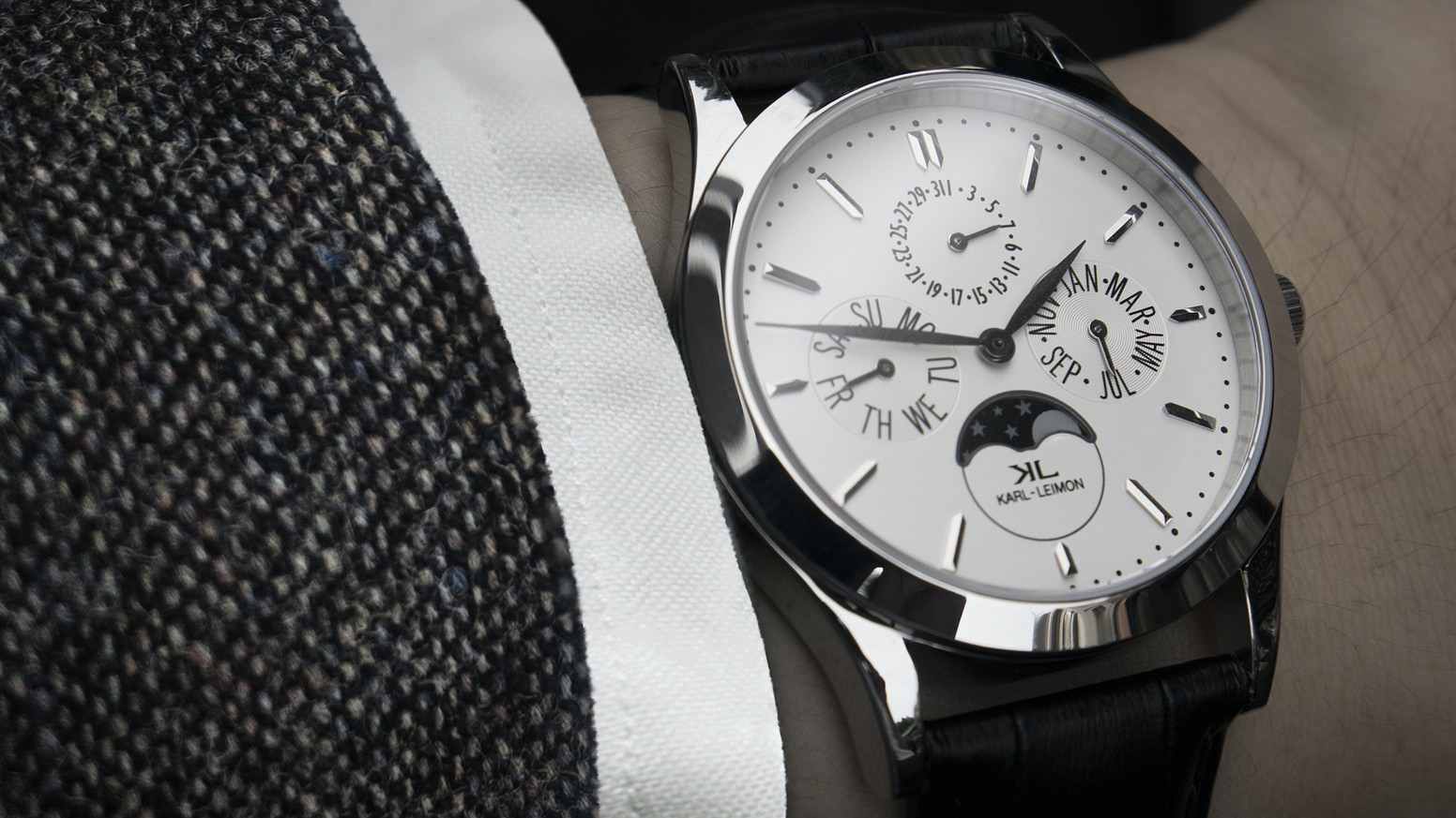Capture the sleek style of a classic moonphase watch at an affordable price. - KARLLEIMON