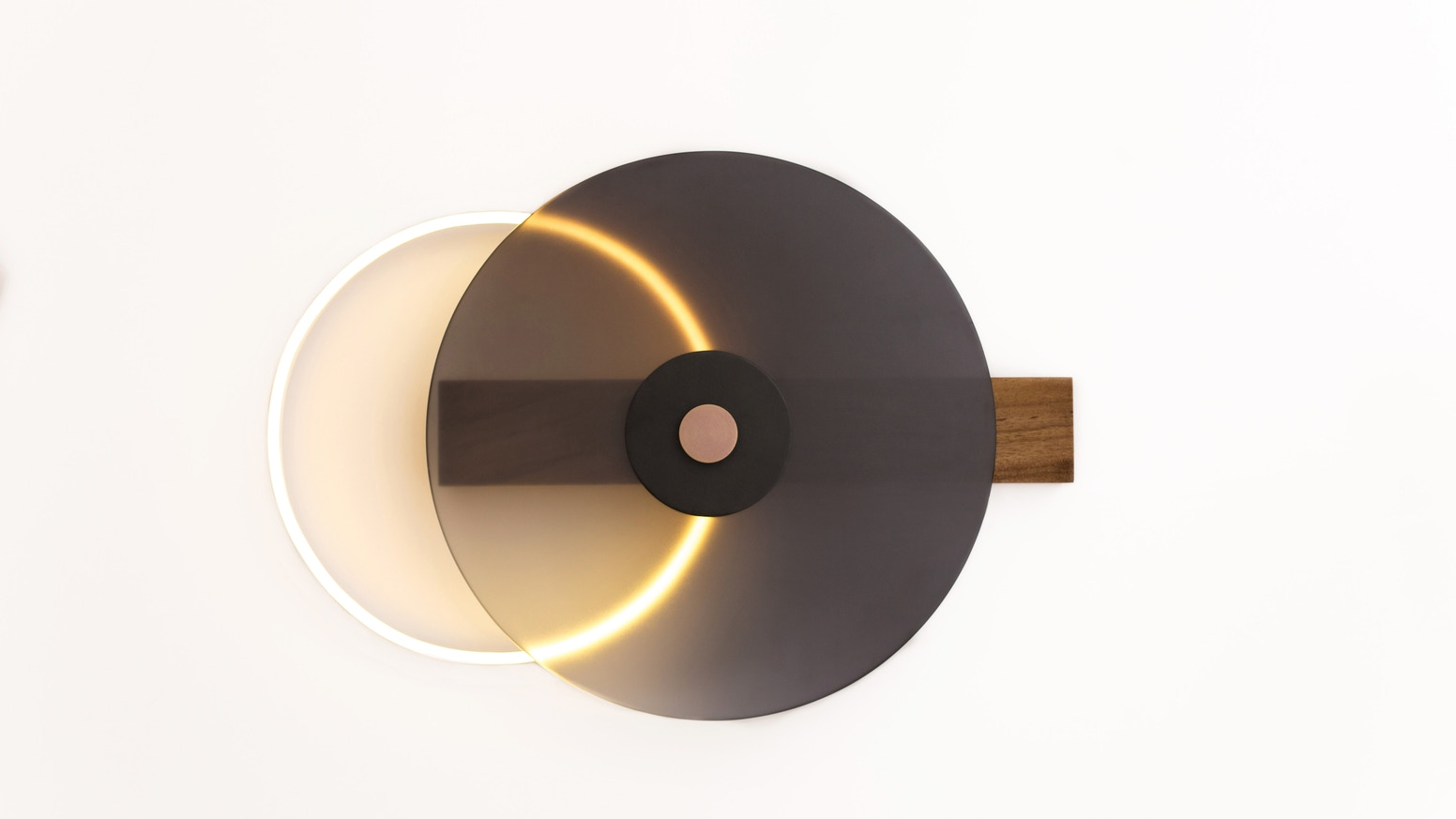 Projects of earth lmpara binomios by comite de proyectos kickstarter a wall lamp that eludes an eclipse as it increases the intensity of its light by moving the frontal screen towards the neon led ring aloadofball Images