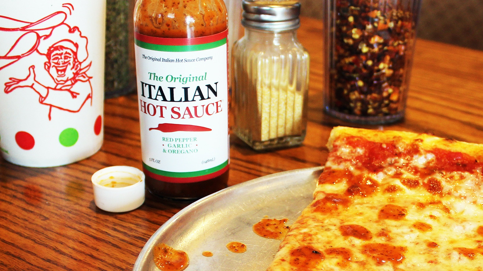 Enjoy the bold Italian flavors of red pepper, garlic, and oregano in our original hot sauce. Perfect on pizza, subs, wings, and more!