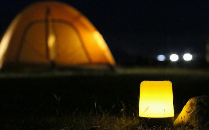 Flickering beside the tent
