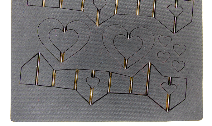 """Example Die from the Heart kit. You can see the """"fold"""" blades - look at those vertical lines."""