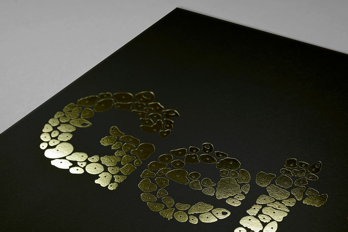 An existing poster produced by Alex, which features gold foil stamped onto Ebony Colorplan