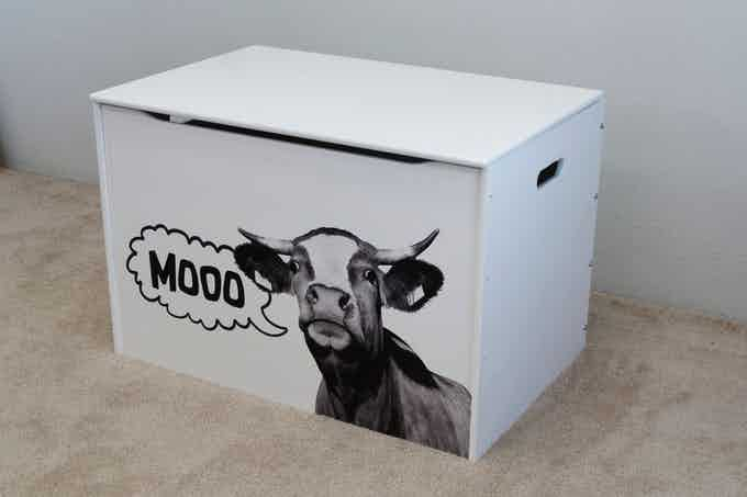 """Stock Design: """"Moo Cow"""" was originally conceived as a custom illustration for our grandson's toy box, but everyone loves it so much that we will offer it as a stock design. Shown on our Big Toy Box in white."""
