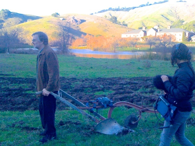 Gary Rydstrom at Skywalker Ranch at sunset, using an old plow to record sounds for War Horse.