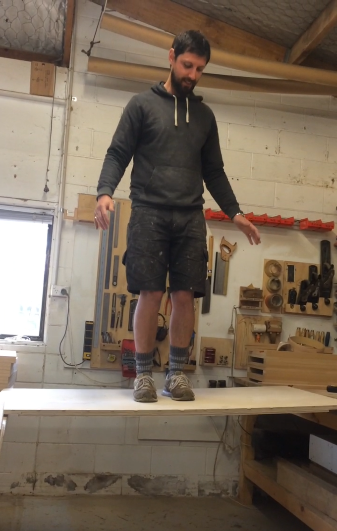 Phil testing out the strength of the Snap Jack table top on an early prototype - 84kgs (185lbs)