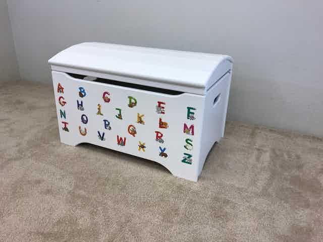 "Stock Design: ""Alphabet Animals"" on our Treasure Chest, shown in white."