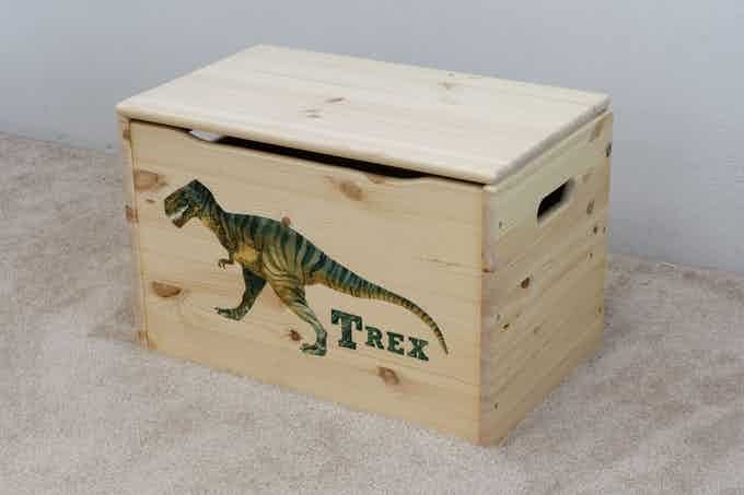 """Stock Design: """"T Rex"""" on our Keepsake Toy Box, shown in our natural finish"""