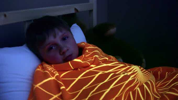 Boy wrapped up in his Force Field Cloak, no fear of the dark now.